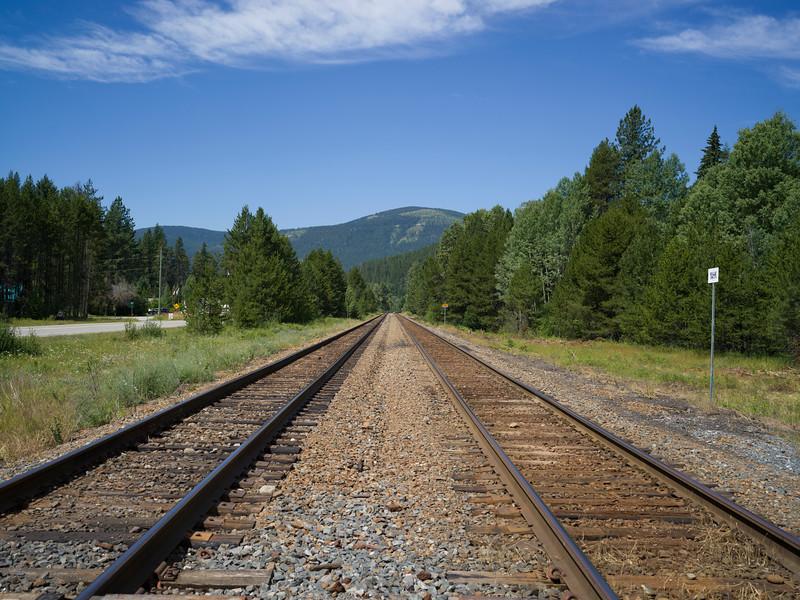 Railroad track passing through field, Cranbrook, British Columbia, Canada