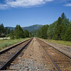 Railroad track passing through field, Cranbrook, British Columbia, Canada