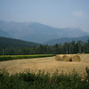 Farmland with mountain range in the background, Golden, British Columbia, Canada