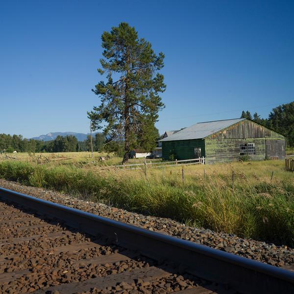 Railroad passing through field, British Columbia Highway 93, British Columbia, Canada