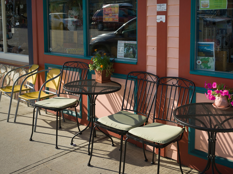 Tables and chairs outside restaurant, Kaslo, West Kootenay, British Columbia, Canada