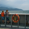 Two boys looking at lake from boat, British Columbia, Canada