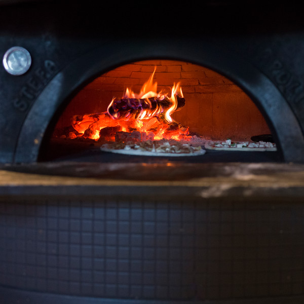 Pizza being baked in traditional oven, Stonefire Pizzeria, Kimberley, British Columbia, Canada