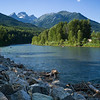 River with mountain range in the background, East Kootenay, British Columbia, Canada
