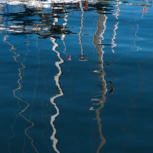 Reflection of sailboat masts on water, Fisherman's Wharf, Inner Harbour, Victoria, Vancouver Island, British Columbia, Canada