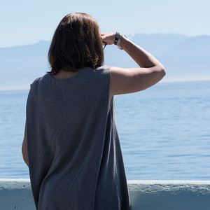 Rear view of a woman looking the ocean, Victoria, Vancouver Island, British Columbia, Canada