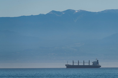 Ship on the ocean with mountain range in the background, Victoria, Vancouver Island, British Columbia, Canada