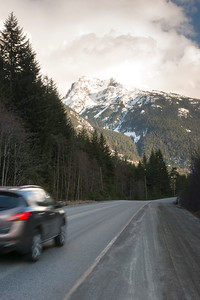 Car moving on the road through mountains, Whistler, British Columbia, Canada
