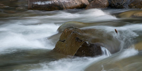 Stream flowing through rocks, Whistler, British Columbia, Canada