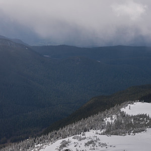 View of snow covered valley with mountains in winter, Whistler Mountain, British Columbia, Canada