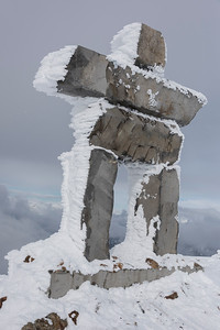 Snowy inuksuk in winter, Whistler, British Columbia, Canada