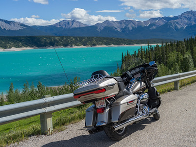 Motorcycle parked at roadside near Abraham Lake, David Thompson Highway, Clearwater County, Alberta, Canada