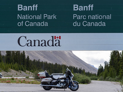Motorcycle parked near signboard, Icefields Parkway, Banff National Park, Jasper, Alberta, Canada