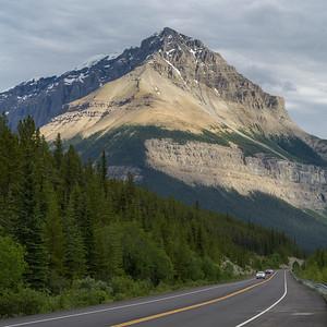 Sunlight on mountain peak, seen from Icefields Parkway, Jasper, Alberta, Canada