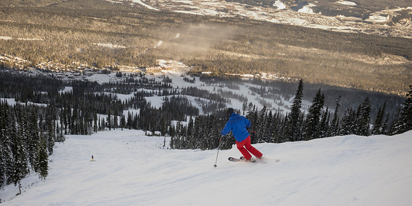 Tourist skiing in valley,  Kicking Horse Mountain Resort, Golden, British Columbia, Canada
