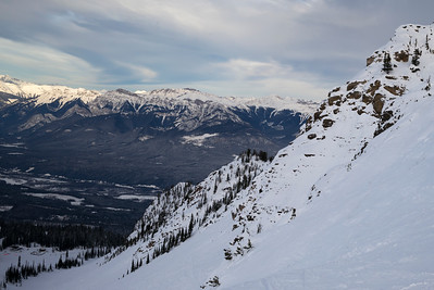 Snow covered valley with mountains in winter,  Kicking Horse Mountain Resort, Golden, British Columbia, Canada