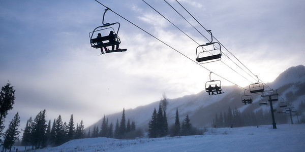 Tourists on ski lifts in valley,  Kicking Horse Mountain Resort, Golden, British Columbia, Canada