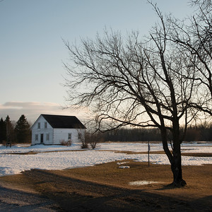 Winter landscape with a house in the background, Riverton, Hecla Grindstone Provincial Park, Manitoba, Canada