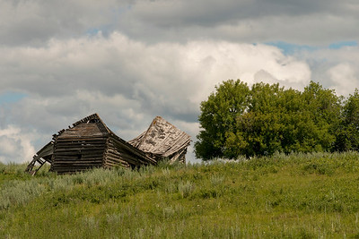 Abandoned farmhouse in a field, Riding Mountain National Park, Manitoba, Canada