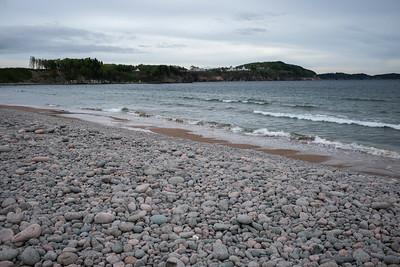 Scenic view of pebbles on beach, Cabot Trail, Cape Breton Island, Nova Scotia, Canada