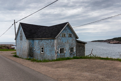 Abandoned house at waterfront, Cabot Trail, Cape Breton Island, Nova Scotia, Canada