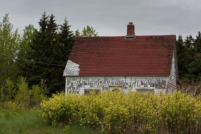 Abandoned house amidst trees, Ingonish, Cabot Trail, Cape Breton Island, Nova Scotia, Canada