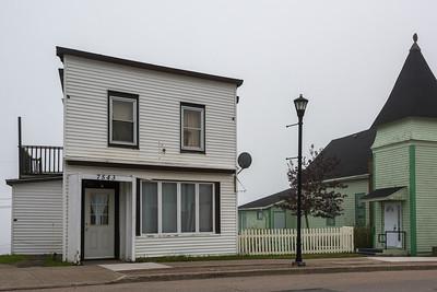 Houses along road in town, Louisbourg, Cape Breton Island, Nova Scotia, Canada