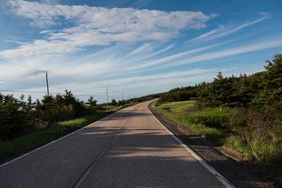 Empty road passing through rural landscape, Margaree Harbour, Cabot Trail, Cape Breton Island, Nova Scotia, Canada