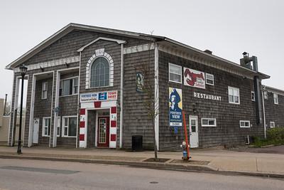 Facade of building by road in town, Louisbourg, Cape Breton Island, Nova Scotia, Canada