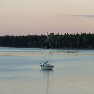 Sailboat in the sea at dusk, Spinnakers Landing, Summerside, Prince Edward Island, Canada