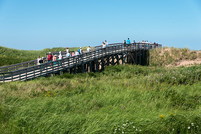 Tourists on wooden bridge at Cavendish Beach, Green Gables, Prince Edward Island, Canada