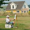 Man painting on canvas, Victoria, Prince Edward Island, Canada