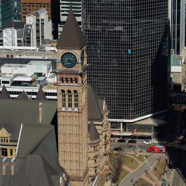High angle view of clock tower of Old City Hall with modern buildings in background, Toronto, Ontario, Canada