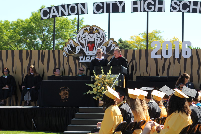 Canon City High School Principal Brett Meuli, left, and school board member Larry Oddo introduces the 2016 class during commencement.