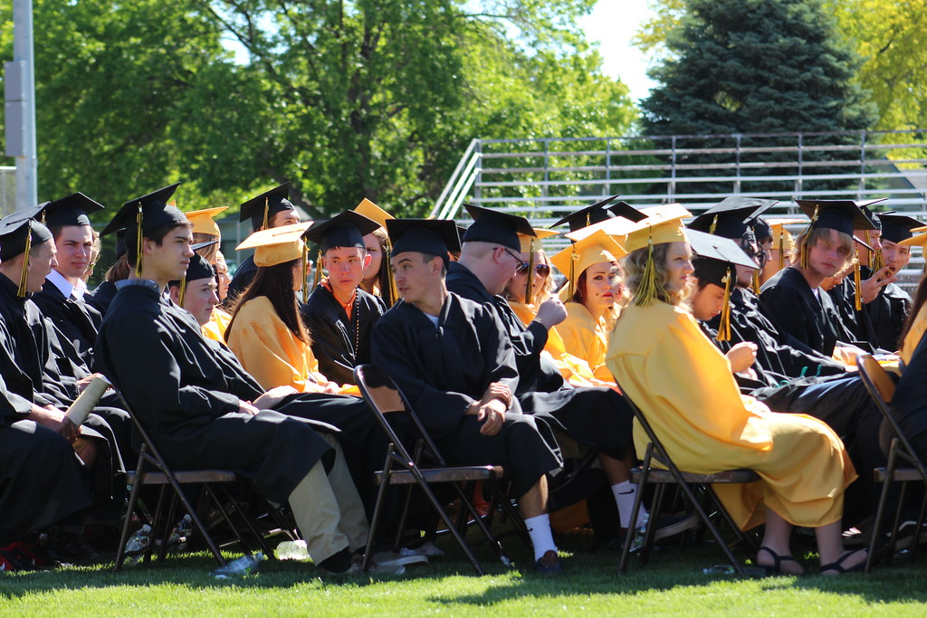 . Graduates wait to line up before receiving their diplomas.