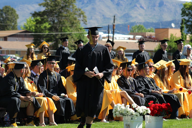 A CCHS grad heads back to his seat.