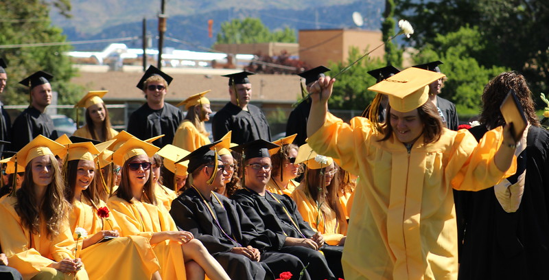 A graduate celebrates after receiving her diploma.