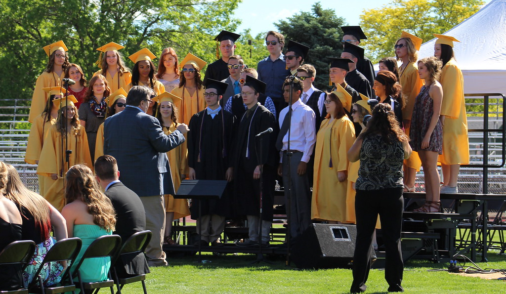 ". The CCHS show choir sings ""Seasons of Love\"" during graduation."