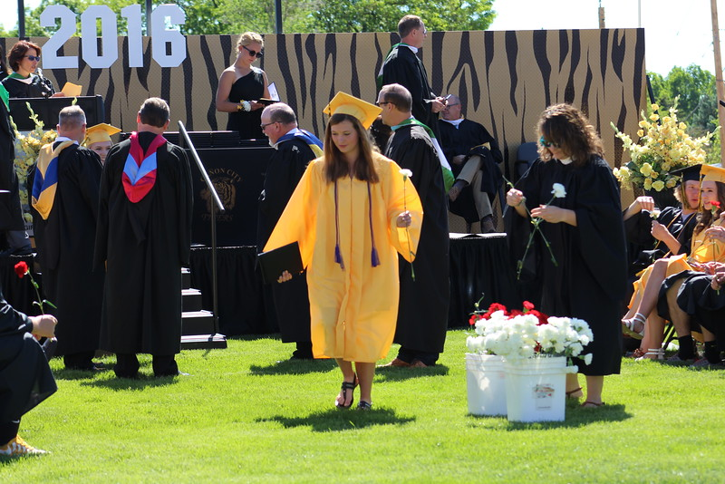 A 2016 grad walks back to her seat after accepting a diploma.