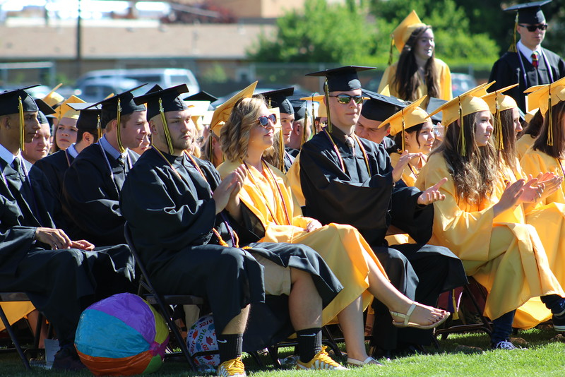 Graduates clap after hearing a speech by the school's head boy, Zachary Manchester.