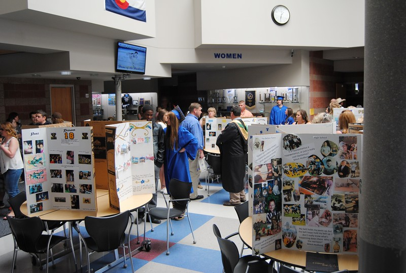 Senior boards on display in the student commons depicting their interpretations of the past, present and future.