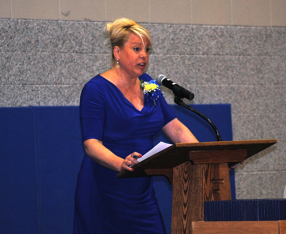 Keynote speaker and former Colorado Rep. Buffie McFadyen speaks Sunday during the Florence High School commencement.