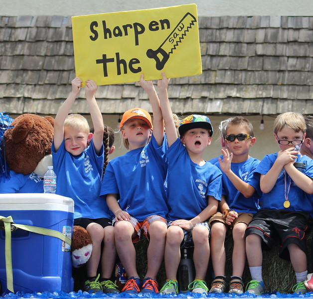Washington Elementary School students ride along Saturday through the 2017 Blossom Festival Parade.