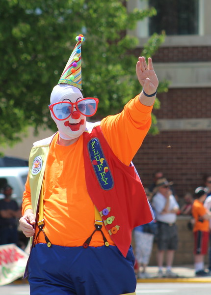 An Al Kaly clown walks through the 2017 Music and Blossom Parade.