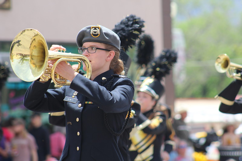 A member of Cañon City High School's marching band walks through the 2017 Music and Blossom Parade Saturday.