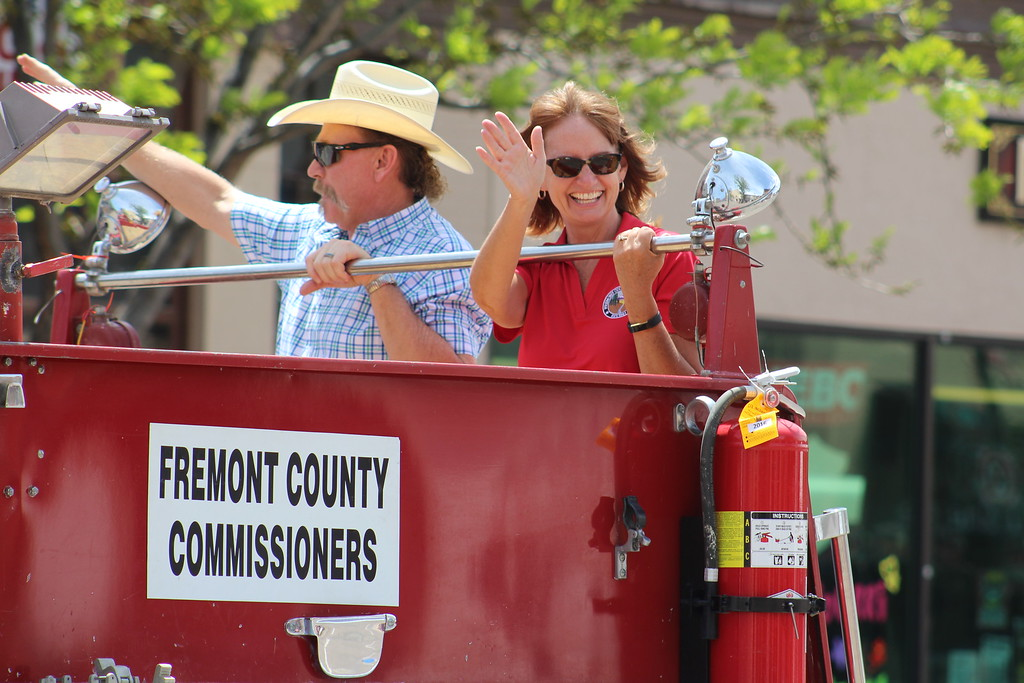 . Fremont County Commissioners Dwayne McFall and Debbie Bell ride in a float Saturdau during the 2017 Music and Blossom Festival.