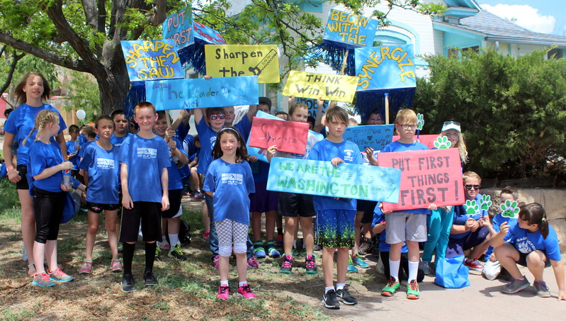 Washington Elementary School students prepare to walk Saturday in the 2017 Blossom Festival Parade.