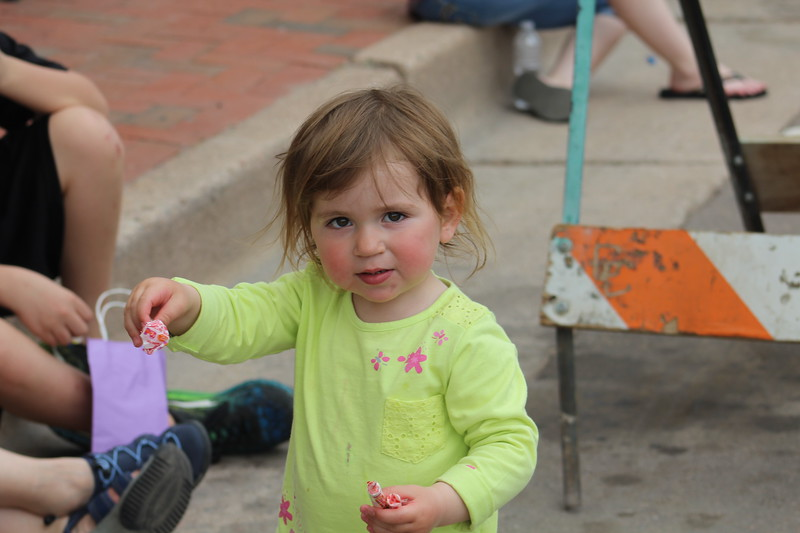 A parade attendee gets candy Saturday in the 2017 Blossom Festival Parade.
