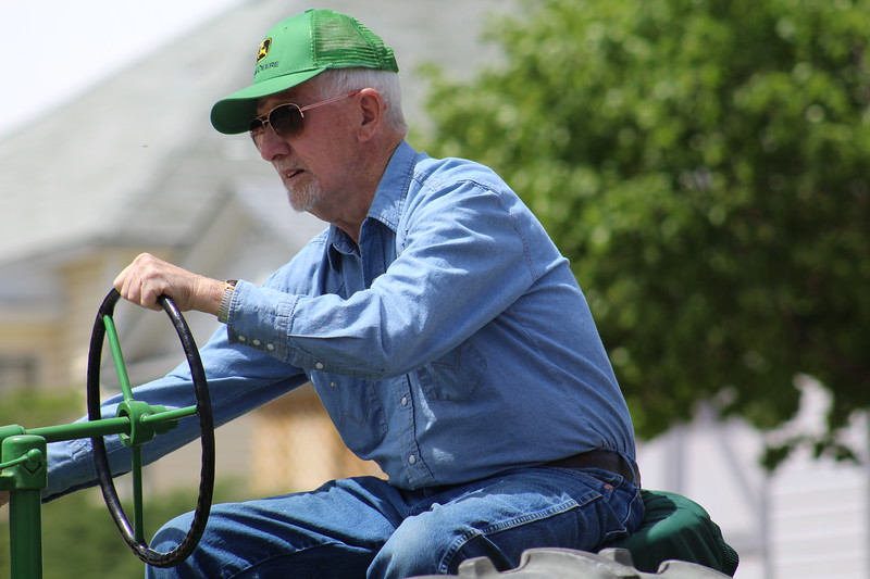 A parade member rides along Saturday through the 2017 Blossom Festival Parade.