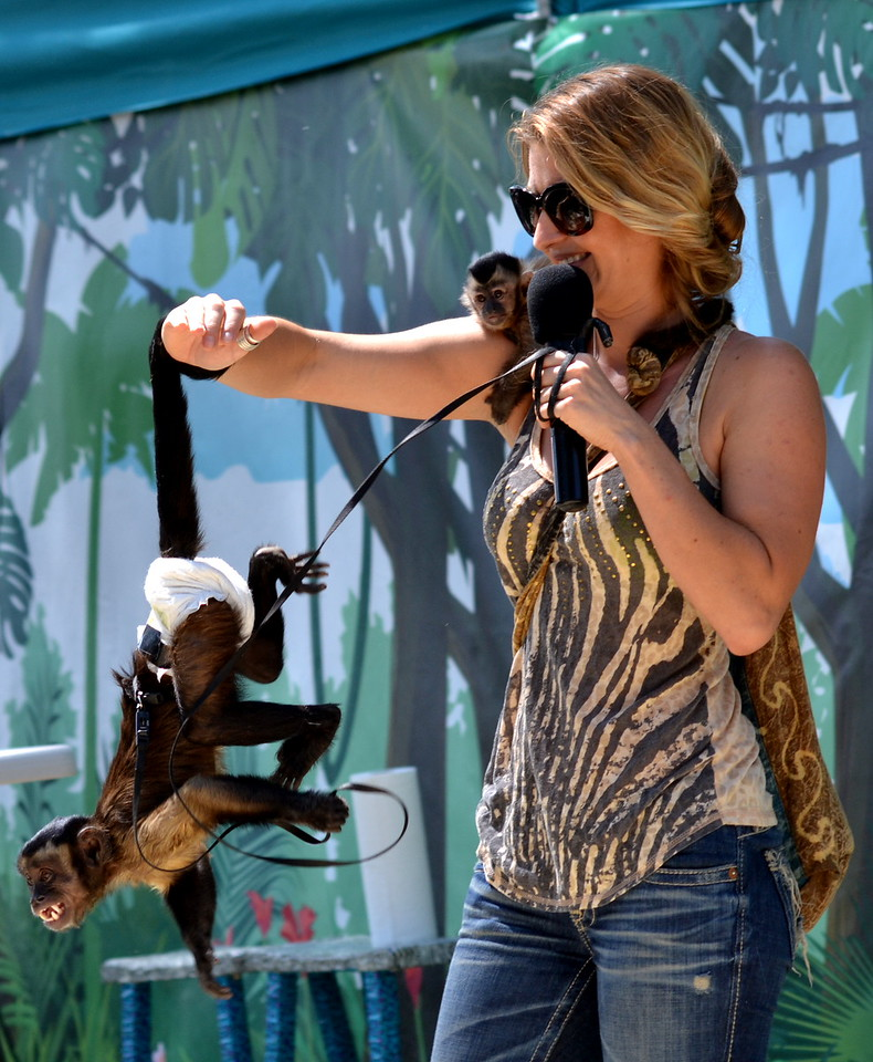 Martina Keith performs Saturday with some monkey friends at the Colorado State Fair in Pueblo.
